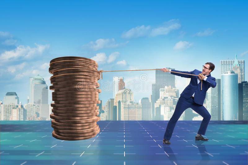 The businessman pulling stack of gold coins. Businessman pulling stack of gold coins royalty free stock photo