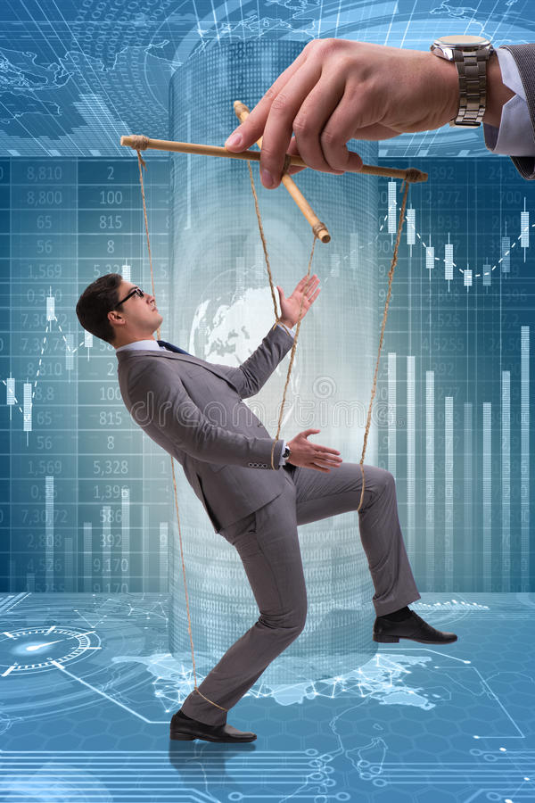 The businessman puppet being manipulated by boss stock photography