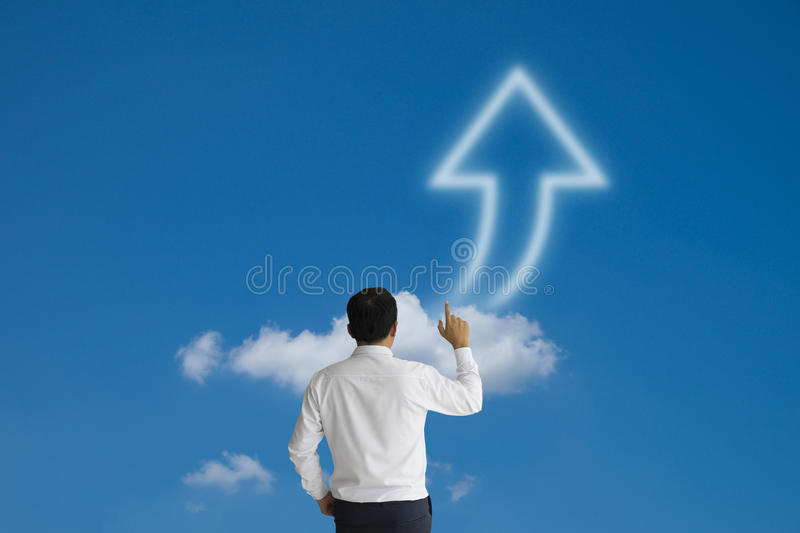 Businessman purposefully looking and touch arrow cloud on blue s stock images