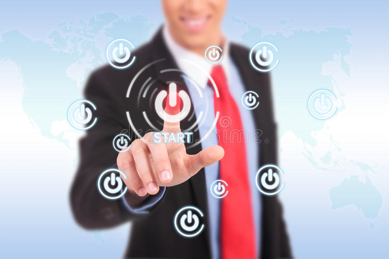 Businessman push the start button. On virtual touch pad royalty free stock images