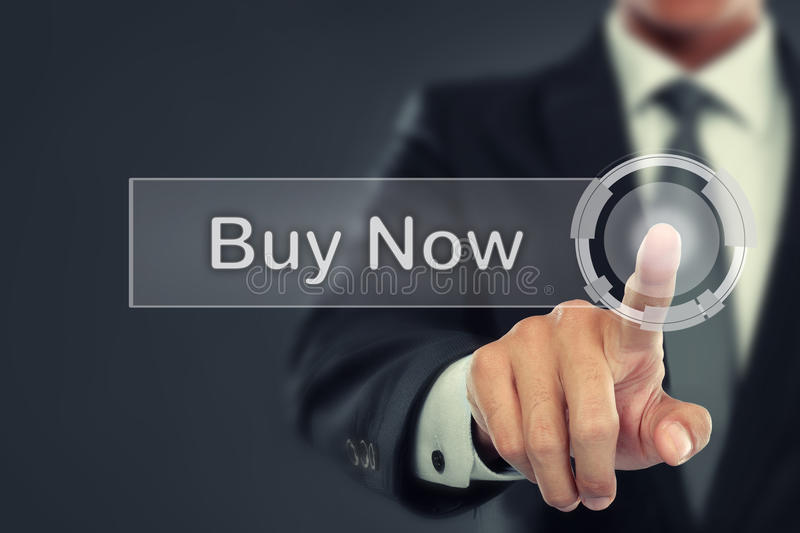 Businessman push to Buy Now button on virtual screen. Portrait of Businessman push to Buy Now button on virtual screen stock photography