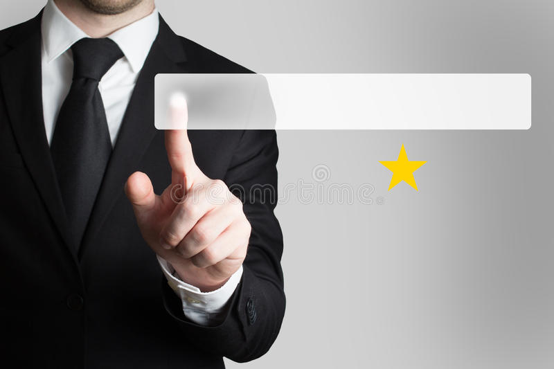 Businessman pushing button one golden star. Businessman in suit pushing button one golden star stock image