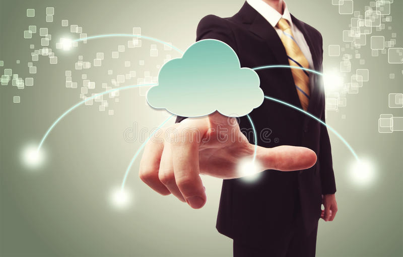 Businessman pushing cloud icon royalty free stock photography