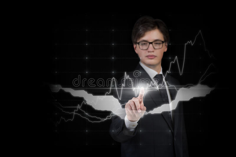 Businessman pushing forex graph royalty free stock photography