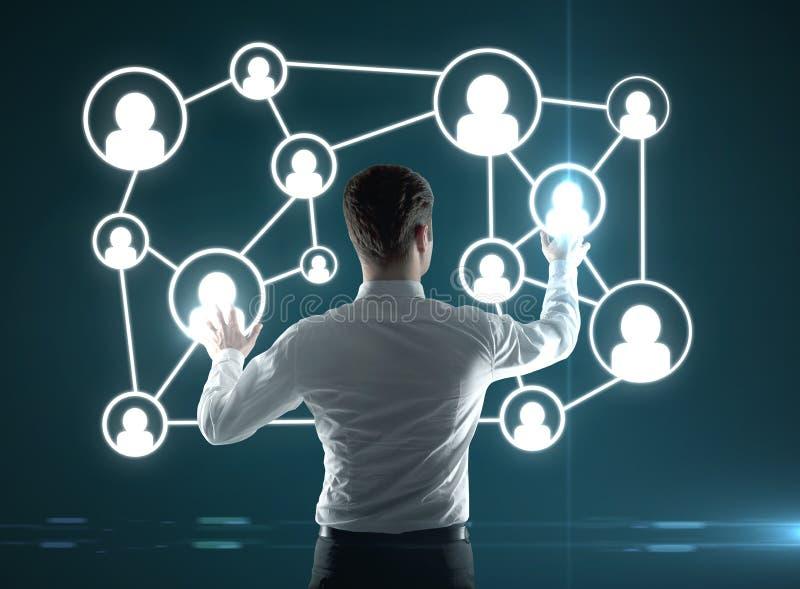 Man pushing interface. Businessman pushing interface with social icons
