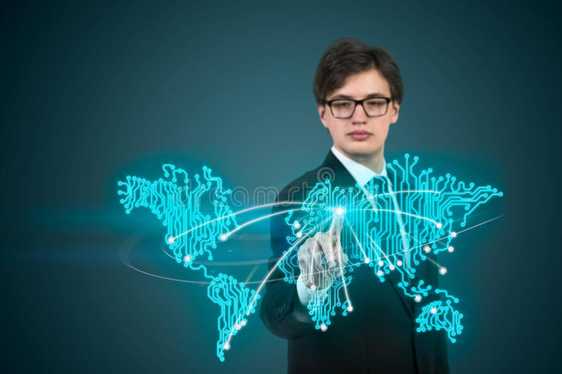 Businessman pushing map. Businessman pushing fingers world map on green background stock photos