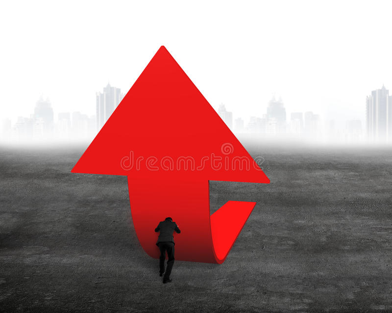 Businessman pushing red trend 3D arrow upward. On concrete floor with cityscape skyline background stock photography