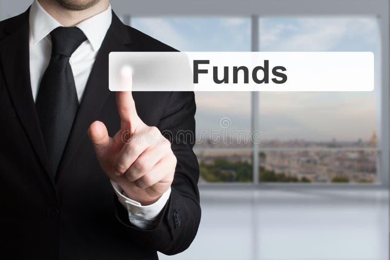 Businessman pushing touchscreen button funds stock photos