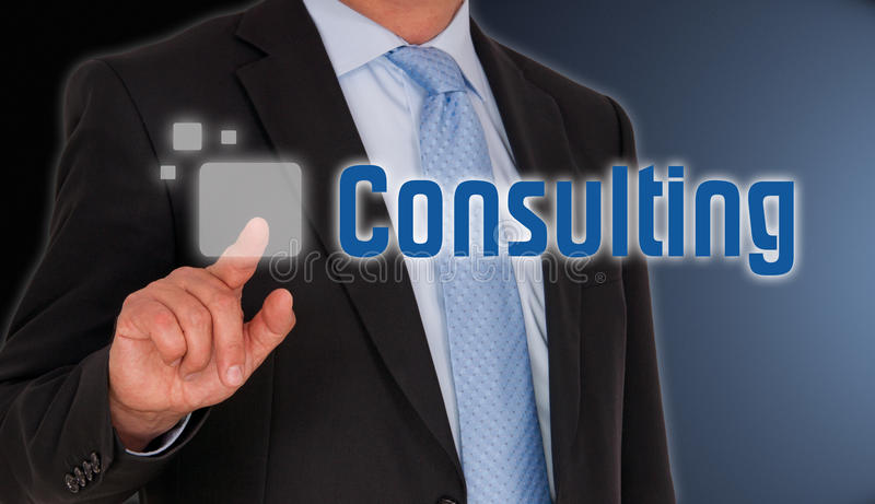 Consulting. A businessman pushing a touchscreen button with the word consulting