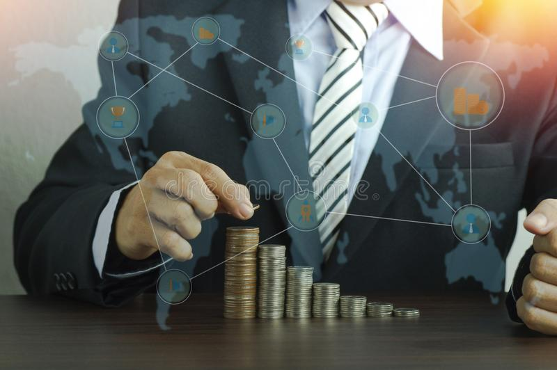 Businessman put money pile of coins, concept in growth, save and investment. In business stock photos