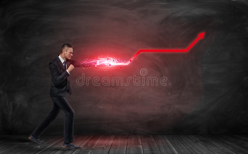 Businessman putting out hand like fighter and making red kinked arrow stock photos