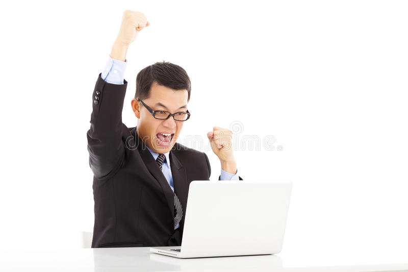 Businessman Raise His Hands To Celebrate Victory Stock Photo