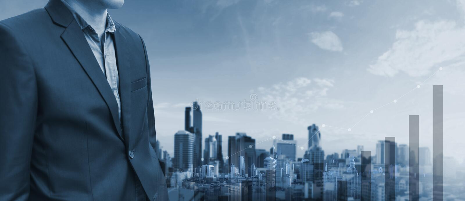 Businessman and raising graph diagram with city background. Business growth and investment stock image