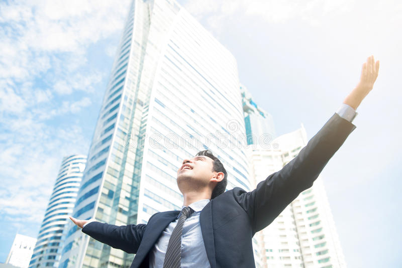 Businessman raising his arms, open palms, with face looking up royalty free stock photos