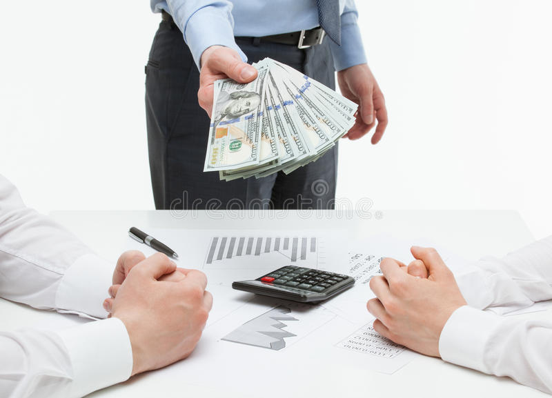 Businessman reaching out money for his business partner stock images