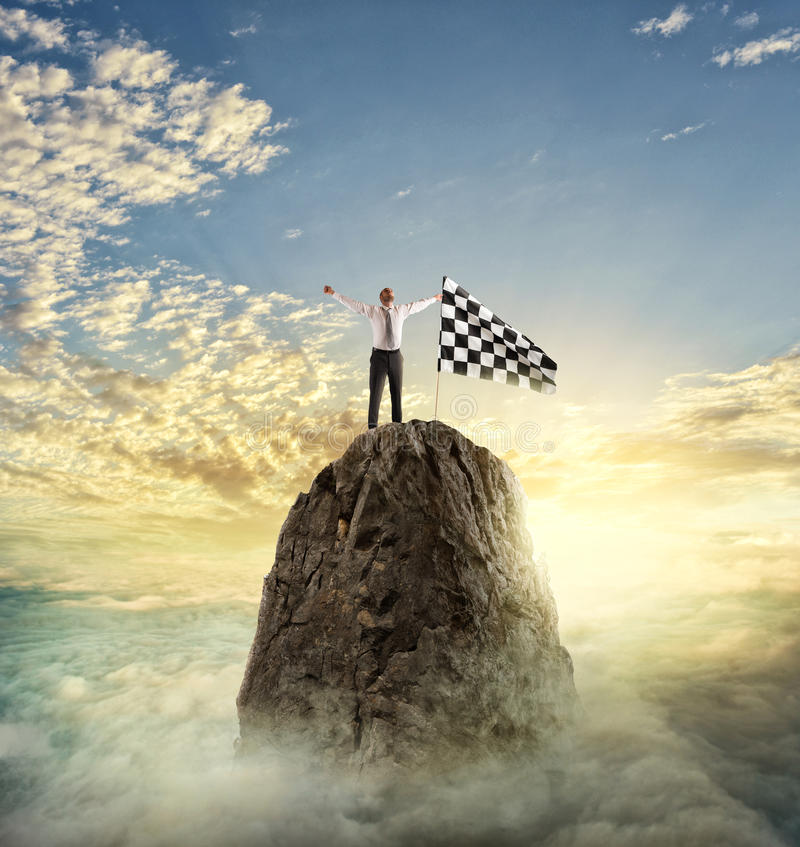 Businessman reachs the goal. Determination concept. Businessman gets the flag in a mountain. Achievement business goal and determination concept stock image