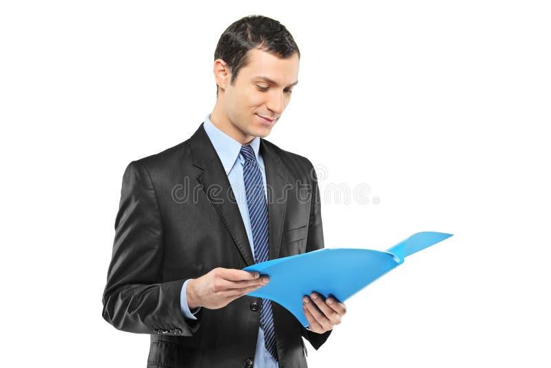 Businessman reading a document stock photos