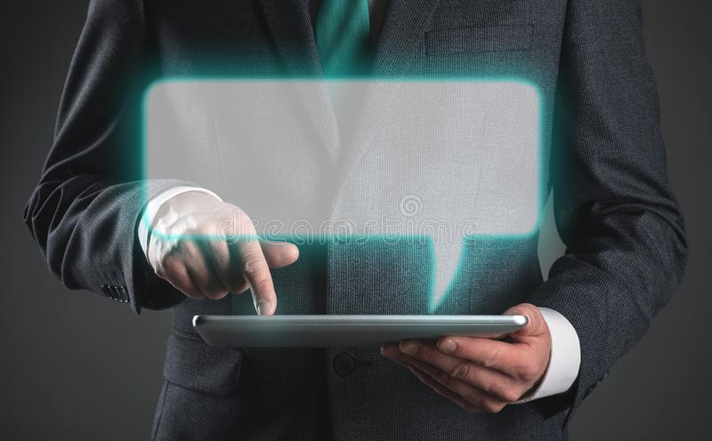 Message. Businessman is reading an email message mock up on his digital tablet computer. Contact us template, letter, person, using, check, checking, post, sms royalty free stock photos