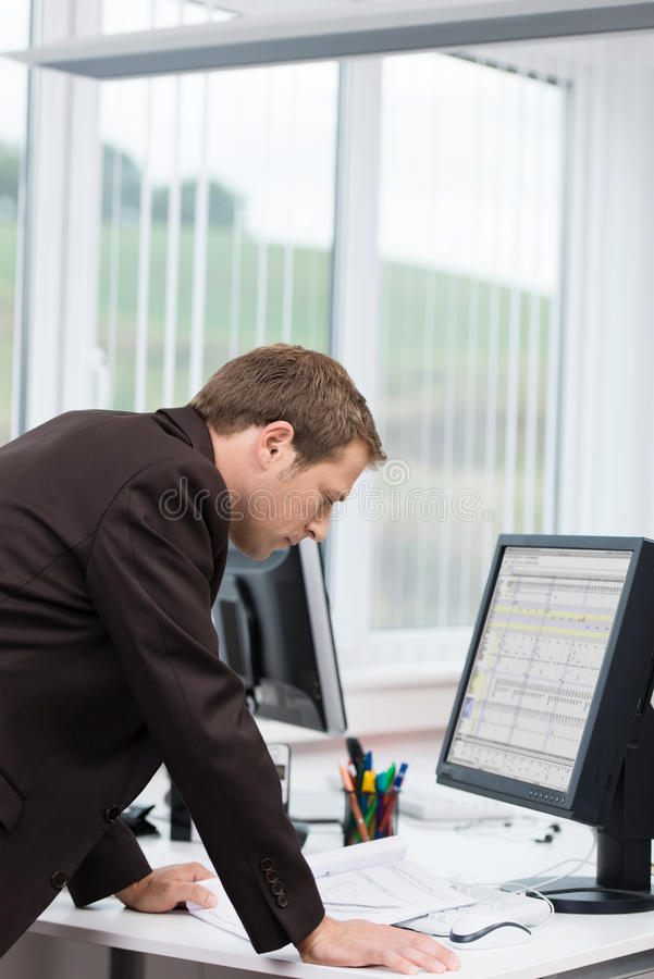 Download Businessman Reading Information On The Computer Stock Image - Image: 33461561