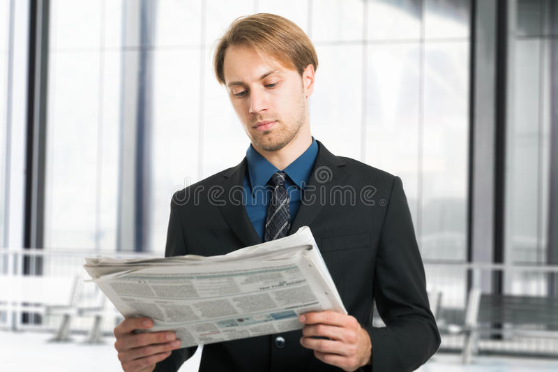 Download Businessman Reading A Newspaper Stock Photo - Image: 28670216