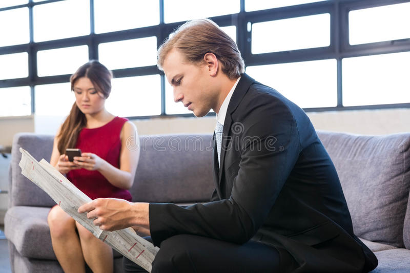 Businessman reading a newspaper royalty free stock image