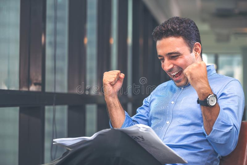 Businessman reading newspaper over office building. Businessman happy smiling after reading goods news. Man goot a new job royalty free stock photos