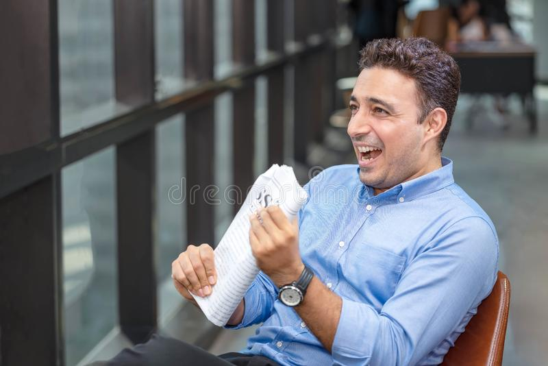 Businessman reading newspaper over office building. Businessman happy smiling after reading goods news. Man goot a new job stock images
