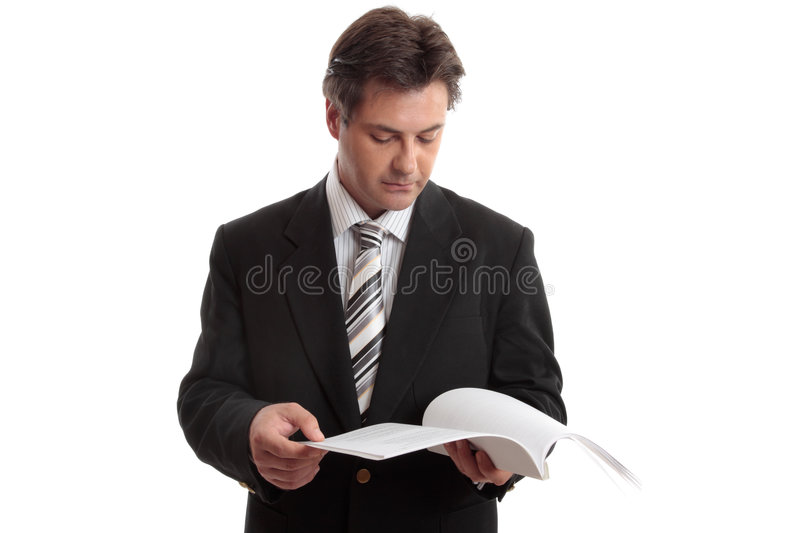 Businessman Reading Report Stock Image