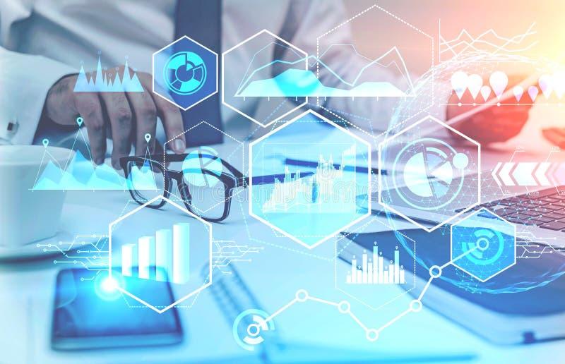 Businessman reading report, digital graphs royalty free stock image