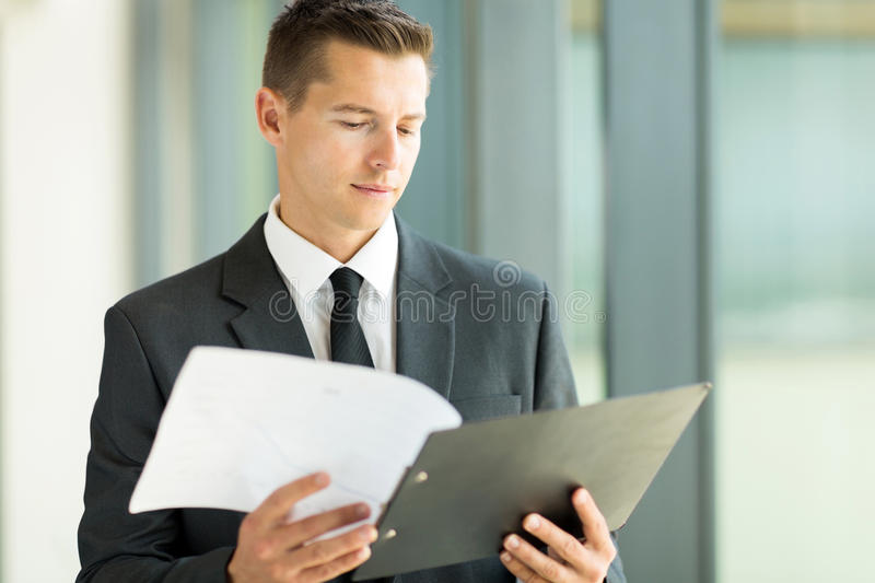 Businessman reading report stock photos