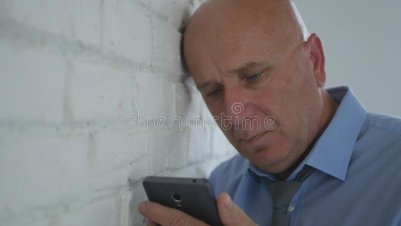 Businessman Reading Upset and Disappointed Financial Bad News on Mobile Phone.  stock images