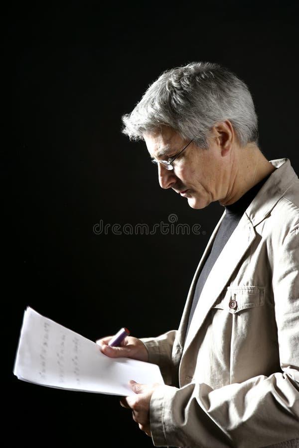 Businessman reading at work, senior gray hair royalty free stock photos
