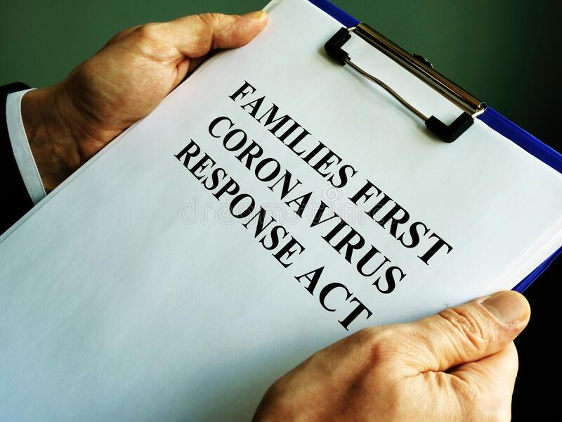 Businessman reads families first coronavirus response act FFCRA. Businessman holds families first coronavirus response act FFCRA royalty free stock photography