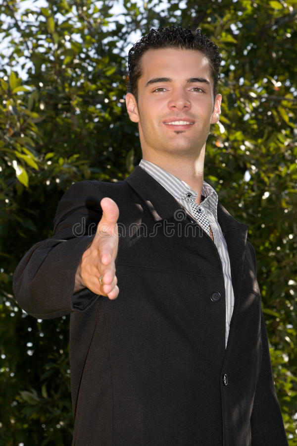 Businessman ready to shake hands stock images