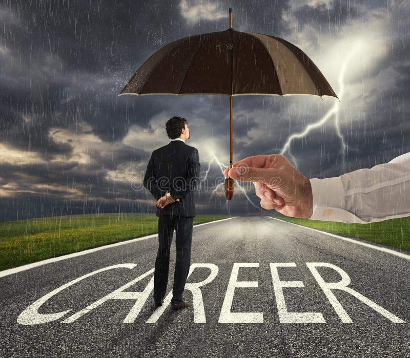 Businessman ready to start a difficult career way with a big help of an umbrella. concept of support and assistance royalty free stock photography
