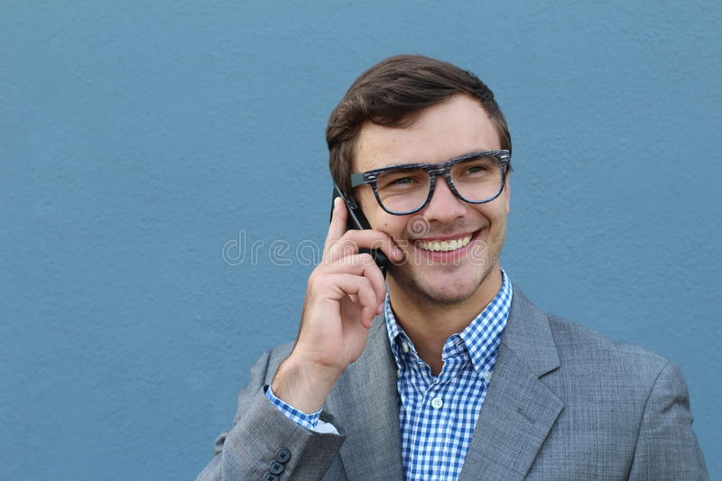 Businessman receiving encouraging news on the phone stock image
