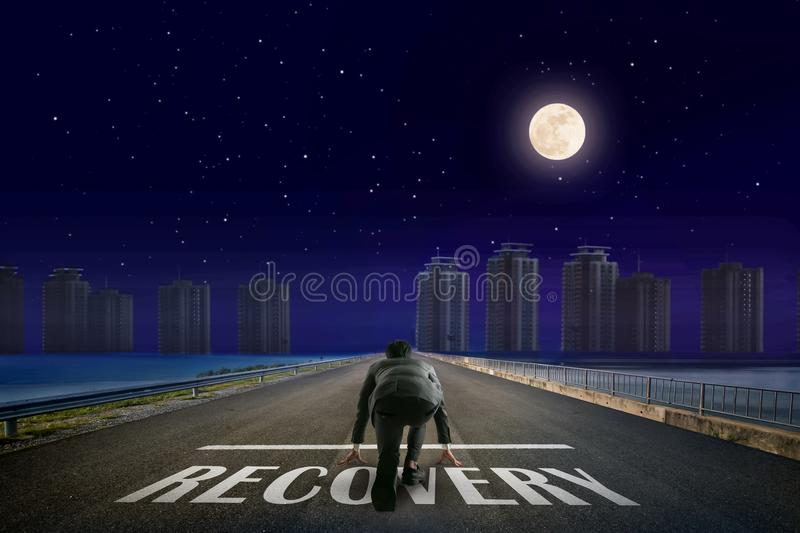 Businessman RECOVERY line in front of city. Night back view. Elements of this image furnished by NASA. stock photography