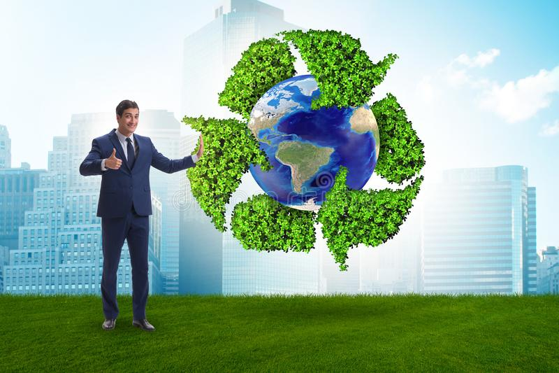 The businessman in recycling ecological concept. Businessman in recycling ecological concept royalty free stock photos