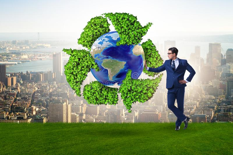 The businessman in recycling ecological concept. Businessman in recycling ecological concept stock photography