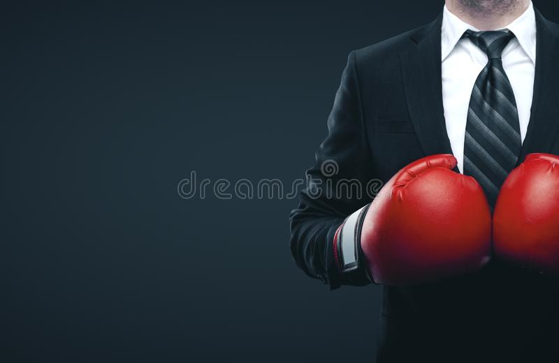Businessman in red boxing gloves. Isolated on gray background. Business challenge concept stock photography