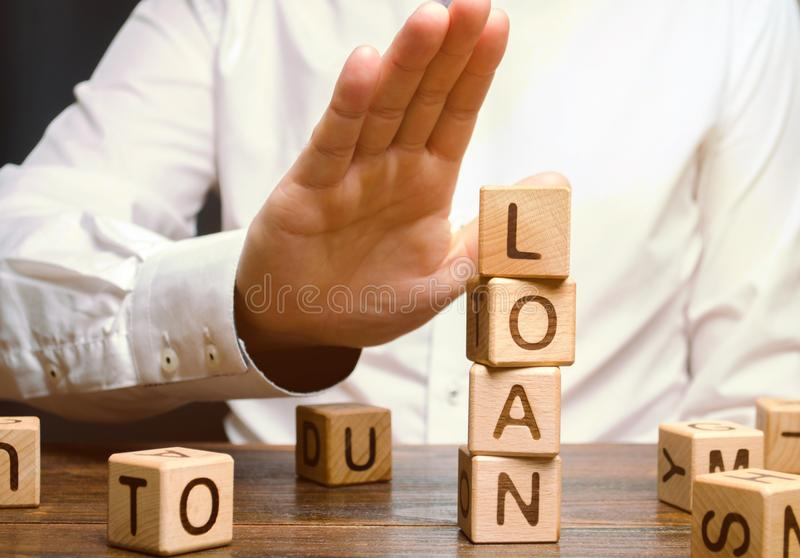 The businessman refuses expensive and risky loans. Business management and investment search. The bank refuses to issue a loan royalty free stock photos