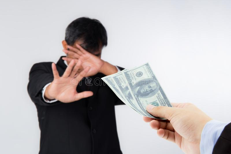 Businessman refuses to receive money - no bribery and corruption concept. The businessman refuses to receive money - no bribery and corruption concept stock photo