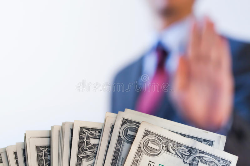 Businessman refuses to receive money - no bribery and corruption. Concept stock photo