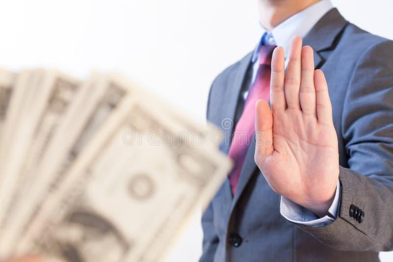 Businessman refuses to receive money - no bribery and corruption. Concept stock photos