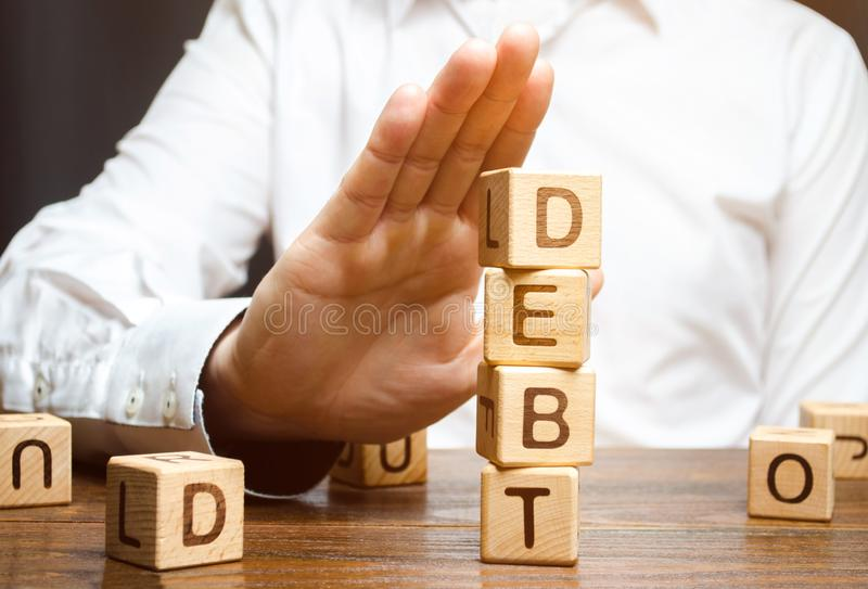 Businessman refuses to take a loan. Refusal of loans with high interest rates. Inability to pay the debt. Unprofitable terms. Of business lending by banks royalty free stock image