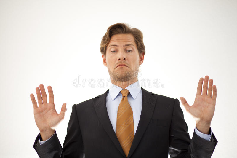 Businessman refusing by backing off. Businessman backing out of a deal or refusing to participate stock image