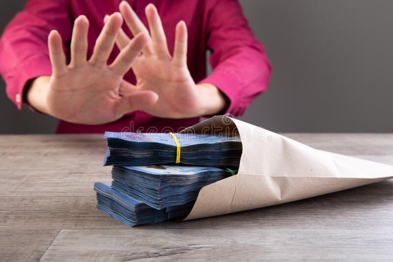 Businessman refusing money in the envelope royalty free stock photography