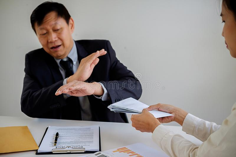 Businessman refusing money in the envelope to agreement contract stock image