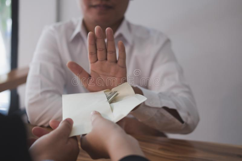 Businessman rejecting money cash banknote from business people. royalty free stock image