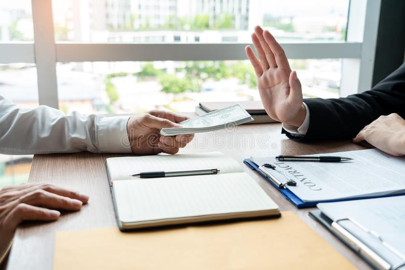 Businessman rejecting money or refusing money form of dollar bills to take the bribe to agreement contract, anti bribery and. Corruption concept stock photography